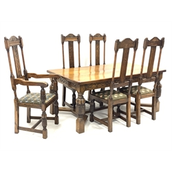 Early 20th century English oak dining table, rectangular top over scrolled foliage carved frieze, turned and carved cup and cover supports joined by angular moulded stretchers (178cm x 101cm, H76cm), and set five (4+1) high back dining chairs with scroll and leaf carved cresting rail and backs upholstered drop in seats