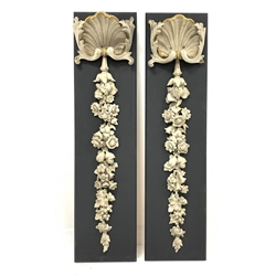 * Pair of early Victorian parcel-gilt and white painted wall pendants each with stylised clam shell issuing foliage H114cm W30cm Provenance: Supplied under the direction of Sir Charles Barry to Henry Lascelles 3rd Earl of Harewood for the gallery at Harewood House in the 1840s and by descent at Harewood House - <a href='https://www.dugglebystephenson.com/auctions/harewood-house.aspx'>Read more...</a>