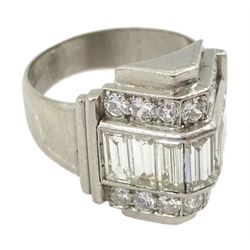 Platinum baguette and round brilliant cut diamond ring, the central row with seven channel set baguette cut diamonds, each side with seven round brilliant cut diamonds, in a stepped triangular design setting