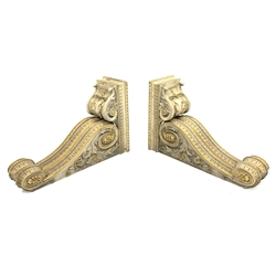 * Pair of early Victorian parcel-gilt and white painted architectural brackets formed as two adjacent scrolling corbels supporting a deep overhanging plinth with additional scroll support H104cm x W33cm x D69cm. Provenance: Supplied under the direction of Sir Charles Barry to Henry Lascelles 3rd Earl of Harewood for the gallery at Harewood House in the 1840s and by descent at Harewood House - <a href='https://www.dugglebystephenson.com/auctions/harewood-house.aspx'>Read more...</a>