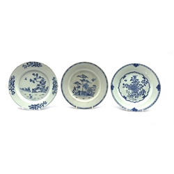 Three Chinese Export blue and white plates, two decorated with a fence garden and the other with chrysanthemum flowers, each D23cm