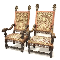 Pair of late 19th / early 20th century  Italian carved walnut high back chairs, each with gilt acanthus carved pediments over upholstered seat and back panels, scrolled arms, raised on leaf carved block supports, W85cm