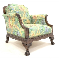 Early 20th century mahogany Georgian style armchair, shaped back, out swept arms, vitruvian scroll rails, on hairy paw feet, upholstered in 'Hydrangea bird' linen by C.P. and J. Baker, W77cm, H77cm, D80cm