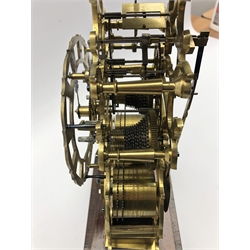 Victorian circa. 1864 brass skeleton clock, twin fusee movement striking on bell, pierced silvered Roman chapter ring, on rosewood plinth with inscribed presentation plaque '...to Mr Smith... British School Committee... Jan 1864', with pendulum, total height of clock including plinth - 41cm