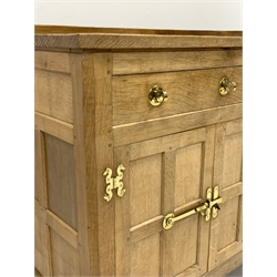 'Eagleman' adzed oak dresser, three drawers above two double cupboards enclosed by four panelled doors, brass fittings, by former 'Mouseman' apprentice Albert Jeffray of Sessay, Thirsk, W148cm, H86cm, D47cm
