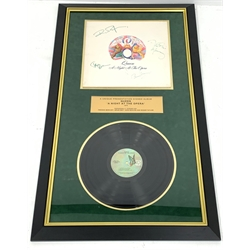 Queen presentation signed album 'A night at the opera', signed by Freddie Mercury, Brian May, John Deacon and Roger Taylor, presented in a frame