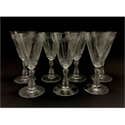 Set of seven early 20th century claret glasses decorated in the Baccarat style with foliate engraved bowls on faceted stems, one (a/f)