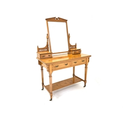 Edwardian satin walnut dressing table with mirror back over two trinket drawers, well figured top, drawer under, raised on square tapered supports united by under tier, W107cm
