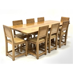'Eagleman' rectangular oak refectory dining table, adzed top on octagonal shaped supports connected by single floor stretcher, shaped sledge feet (199cm x 90cm, H76cm) and set eight oak dining chairs, panelled backs carved with the Yorkshire rose, leather upholstered seats, by former 'Mouseman' apprentice Albert Jeffray of Sessay, Thirsk
