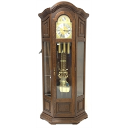 20th century German oak longcase clock, eight day three weight Westminster chiming movement, dial with silvered Roman numeral chapter ring, case with canted sides and six glass shelves, H211cm