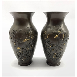 Pair of late 19th/early 20th Century Japanese bronze baluster vases with a raised pattern of birds and flowers highlighted in gilt H19cm