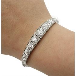 Art Deco white gold graduating old cut diamond bracelet c.1920's, stamped 18ct, the central diamond approx 1.50 carat