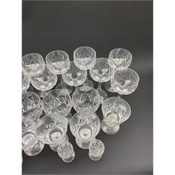 Part suite of Stuart crystal drinking glasses comprising fourteen hock glasses, twelve various shaped claret glasses and four sherry glasses