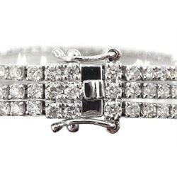 18ct white gold three row round brilliant cut diamond bracelet, stamped 750, with London assay mark, total diamond weight approx 6.80 carat